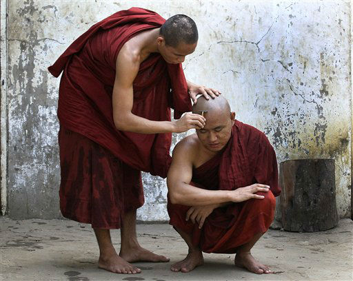 A Myanmar Buddhist monk shaves a fellow monk&#39;s head in Yangon, Myanmar Wednesday, April 25, 2012. &#40;AP Photo&#47;Sakchai Lalit&#41; <span class=meta>(AP Photo&#47; Sakchai Lalit)</span>