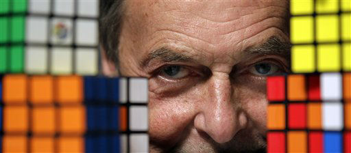 Erno Rubik, the inventor of the Rubik&#39;s Cube, poses for The Associated Press with cubes at Liberty Science Center, Wednesday, April 25, 2012, in Jersey City, N.J. The center will have an exhibit on the toys and will include a cube made with diamonds that is worth 2.5 million dollars. &#40;AP Photo&#47;Julio Cortez&#41; <span class=meta>(AP Photo&#47; Julio Cortez)</span>