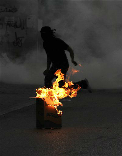 "<div class=""meta ""><span class=""caption-text "">A Bahraini anti-government protester runs from tear gas fired by riot police Thursday, April 26, 2012, in Bilad al-Qadeem, Bahrain, on the outskirts of the capital of Manama, during clashes following a mourning procession for a protester who died last week. The lawyer for a jailed Bahraini activist on a lengthy hunger strike said Thursday he will seek a court order granting him visiting rights to his client. (AP Photo/Hasan Jamali) (AP Photo/ Hasan Jamali)</span></div>"