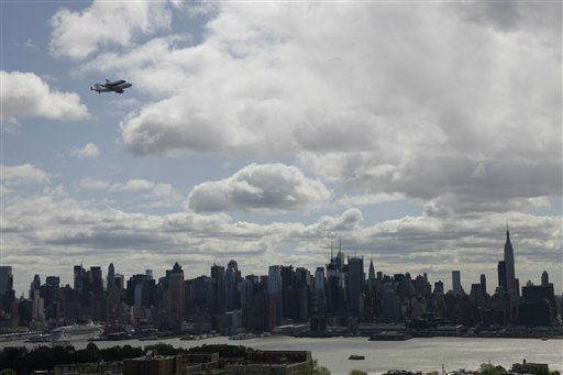 Space shuttle Enterprise, riding on the back of the NASA 747 Shuttle Carrier Aircraft, cruises over the New York City skyline as it makes its way to John F. Kennedy International Airport, seen from Union City, N.J., Friday, April 27, 2012. Enterprise is expected to go on display at the Intrepid Sea Air and Space Museum in New York. &#40;AP Photo&#47;Julio Cortez&#41; <span class=meta>(AP Photo&#47; Julio Cortez)</span>