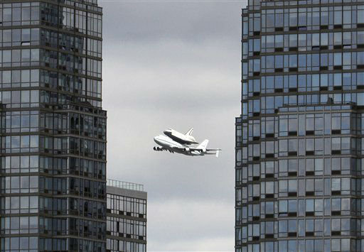 Space shuttle Enterprise, riding on the back of the NASA 747 Shuttle Carrier Aircraft, cruises over the Hudson river,  Friday, April 27, 2012 in New York. Enterprise is eventually going to make its new home in New York City at the Intrepid Sea, Air and Space Museum.  &#40;AP Photo&#47;Mary Altaffer&#41; <span class=meta>(AP Photo&#47; Mary Altaffer)</span>