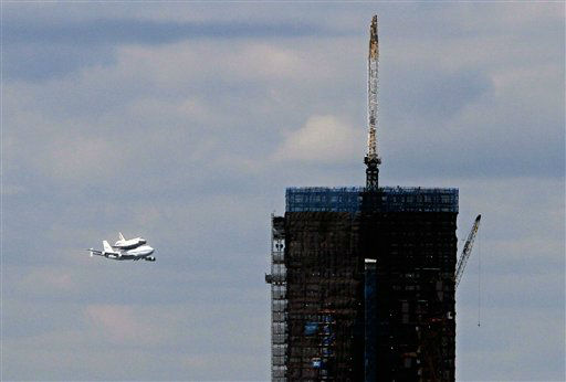 Space shuttle Enterprise, riding on the back of the NASA 747 Shuttle Carrier Aircraft, approaches the One World Trade Center building under construction, as it arrives in New York,  Friday, April 27, 2012. Enterprise is eventually going to make its new home in New York City at the Intrepid Sea, Air and Space Museum. &#40;AP Photo&#47;Richard Drew&#41; <span class=meta>(AP Photo&#47; Richard Drew)</span>
