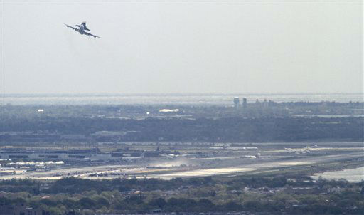The NASA 747 Shuttle Carrier with the Space Shuttle Enterprise on its back, aborts a first attempt at landing at JFK on Friday, April 27, 2012, in New York.  Enterprise will make its new home at New York City&#39;s Intrepid Sea, Air and Space Museum in June.  It landed safely at JFK after a second circle. &#40;AP Photo&#47;Bebeto Matthews&#41; <span class=meta>(AP Photo&#47; Bebeto Matthews)</span>