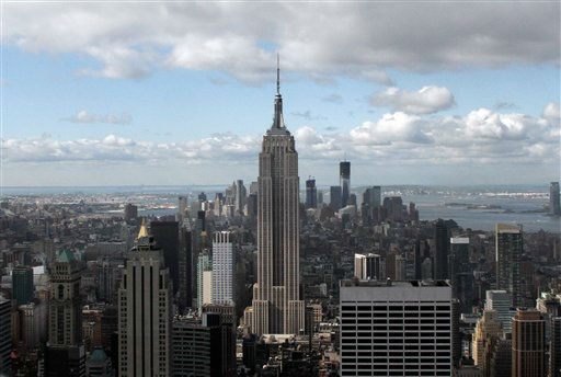 "<div class=""meta image-caption""><div class=""origin-logo origin-image ""><span></span></div><span class=""caption-text"">This April 27, 2012, photo shows the Empire State Building, center, and One World Trade Center, rear right, in New York. One World Trade Center, the giant monolith being built to replace the twin towers destroyed in the Sept. 11 attacks, will lay claim to the title of New York City?s tallest skyscraper on Monday, April 30, as workers erect steel columns that will make its unfinished skeleton a little over 1,250 feet, just high enough to peak over the observation deck on the Empire State Building. (AP Photo/Richard Drew) (AP Photo/ Richard Drew)</span></div>"