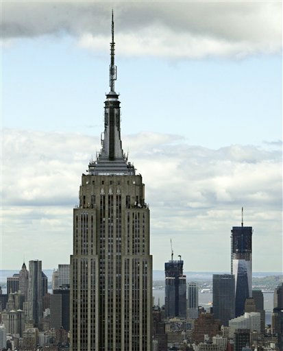"<div class=""meta image-caption""><div class=""origin-logo origin-image ""><span></span></div><span class=""caption-text"">This April 27, 2012, photo shows the Empire State Building, left, and One World Trade Center, right, in New York. One World Trade Center, the giant monolith being built to replace the twin towers destroyed in the Sept. 11 attacks, will lay claim to the title of New York City?s tallest skyscraper on Monday, April 30, as workers erect steel columns that will make its unfinished skeleton a little over 1,250 feet, just high enough to peak over the observation deck on the Empire State Building. (AP Photo/Richard Drew) (AP Photo/ Richard Drew)</span></div>"