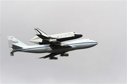 Space shuttle Enterprise, riding on the back of the NASA 747 Shuttle Carrier Aircraft, cruises over the Hudson river,  Friday, April 27, 2012 in New York. Enterprise is eventually going to make its new home in New York City at the Intrepid Sea, Air and Space Museum.&#40;AP Photo&#47;Mary Altaffer&#41; <span class=meta>(AP Photo&#47; Mary Altaffer)</span>