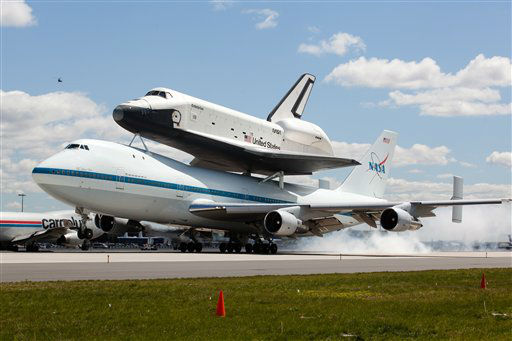 Space shuttle Enterprise, riding on the back of the NASA 747 Shuttle Carrier Aircraft, lands at JFK International Airport, Friday, April 27, 2012, in New York.  Enterprise is eventually going to make its new home in New York City at the Intrepid Sea, Air and Space Museum. &#40;AP Photo&#47;John Minchillo&#41; <span class=meta>(AP Photo&#47; John Minchillo)</span>