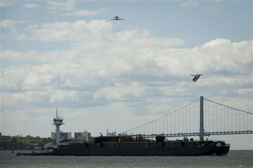 "<div class=""meta ""><span class=""caption-text "">This photo provided by NASA shows Space shuttle Enterprise, riding on the back of the NASA 747 Shuttle Carrier Aircraft, flies over the Verrazano Bridge, Friday, April 27, 2012, in New York. Enterprise is eventually going to make its new home in New York City at the Intrepid Sea, Air and Space Museum. (AP Photo/NASA, Bill Ingalls) (AP Photo/ Bill Ingalls)</span></div>"