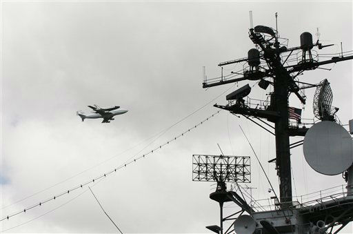 COMMERCIAL IMAGE - In this photograph taken by AP Images for Madison Avenue, the Space Shuttle Enterprise is seen flying over the Intrepid Sea Air and Space Museum on Friday April 27, 2012 in New York. &#40;Ed Rieker&#47;AP Images for Madison Avenue&#41; <span class=meta>(Photo&#47;Ed Rieker)</span>