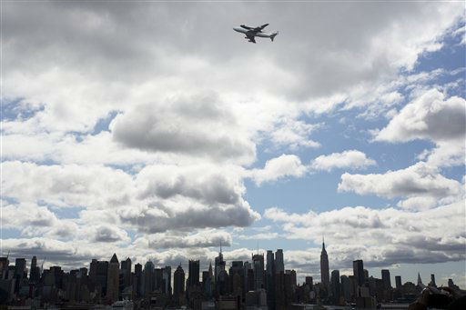 In this photo provided by NASA, Space shuttle Enterprise, riding on the back of the NASA 747 Shuttle Carrier Aircraft, flies over the Hudson River, Friday, April 27, 2012, in New York. Enterprise is eventually going to make its new home in New York City at the Intrepid Sea, Air and Space Museum. &#40;AP Photo&#47;NASA, Matt Hedges &#41; <span class=meta>(AP Photo&#47; Matt Hedges)</span>