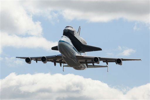 Space shuttle Enterprise, riding on the back of the NASA 747 Shuttle Carrier Aircraft performs a fly-by above JFK International Airport, Friday, April 27, 2012, in New York.  Enterprise is eventually going to make its new home in New York City at the Intrepid Sea, Air and Space Museum. &#40;AP Photo&#47;John Minchillo&#41; <span class=meta>(AP Photo&#47; John Minchillo)</span>