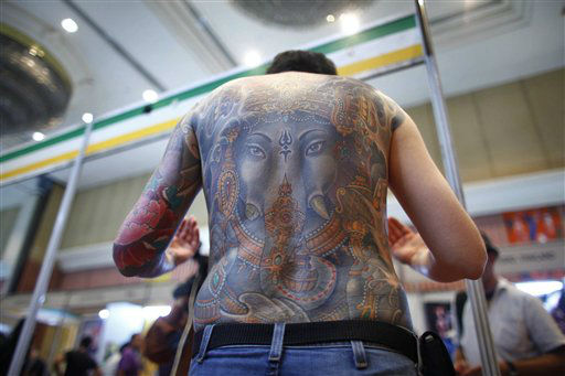 A man displays his tattoo, depicting Hindu elephant headed god Ganesha during the second International Tattoo Convention in Katmandu, Nepal, Sunday, April 29, 2012. Tatoo artists from 15 different countries are participating in the three-day event which concludes Sunday. &#40;AP Photo&#47;Niranjan Shrestha&#41; <span class=meta>(AP Photo&#47; Niranjan Shrestha)</span>