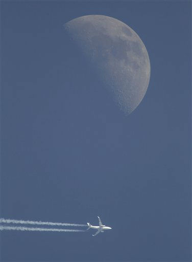 A jet airplane leaves a trail in the sky Sunday evening, April 29, 2012, over Novogrudok, 150 kilometers &#40;93 miles&#41; west of the capital Minsk, Belarus. The waxing crescent moon will be full May 6. &#40;AP Photo&#47;Sergei Grits&#41; <span class=meta>(AP Photo&#47; Sergei Grits)</span>