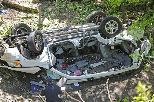 Police investigate the destroyed van that plunged over the Bronx River Parkway, Sunday April 29, 2012, in New York. Authorities say the out-of-control van plunged off a roadway near the Bronx Zoo, killing seven people, including three children. &#40;AP Photo&#47; Louis Lanzano&#41; <span class=meta>(AP Photo&#47; Louis Lanzano)</span>