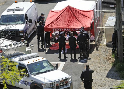 Police surround a temporarily built tent where the victims of the vehicle crash were brought, Sunday April 29, 2012, in New York. Authorities say the out-of-control van plunged off a roadway near the Bronx Zoo, killing seven people, including three children. &#40;AP Photo&#47; Louis Lanzano&#41; <span class=meta>(AP Photo&#47; Louis Lanzano)</span>