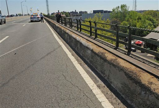 Skid marks and a scraped concrete barrier mark the spot where a van carrying seven occupants plunged off the highway to a wooded area below, Sunday April 29, 2012, in New York. Authorities say the out-of-control van plunged off a roadway near the Bronx Zoo, killing seven people, including three children. &#40;AP Photo&#47; Louis Lanzano&#41; <span class=meta>(AP Photo&#47; Louis Lanzano)</span>