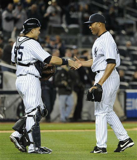 New York Yankees catcher Russell Martin &#40;55&#41; congratulates Mariano Rivera after the Yankees won 2-1 over the Baltimore Orioles in a baseball game on Monday, April 30, 2012, at Yankee Stadium in New York. &#40;AP Photo&#47;Kathy Kmonicek&#41; <span class=meta>(AP Photo&#47; Kathy Kmonicek)</span>
