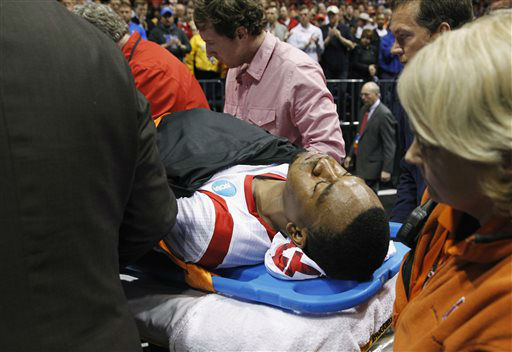 Louisville guard Kevin Ware is taken off of the court  on a stretcher after his injury during the first half of the Midwest Regional final against Duke in the NCAA college basketball tournament Sunday March 31, 2013, in Indianapolis. &#40;AP Photo&#47;Darron Cummings&#41; <span class=meta>(AP Photo&#47; Darron Cummings)</span>