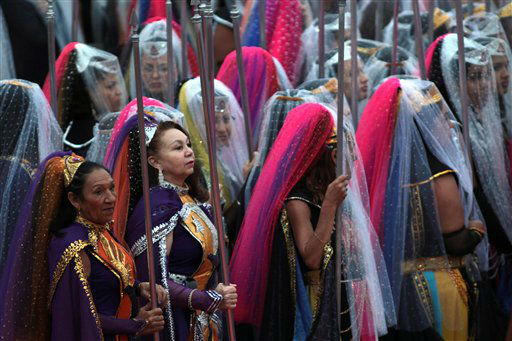 Women from the Sunrise Order dressed as nymphs attend the ritual of the ellipse at the annual festival of the Vale do Amanhecer, or Sunrise Valley Festival, in Planaltina, Brazil, Tuesday, May 1, 2012. Vale do Amanhecer is a spiritual community founded in 1959 by the medium Tia Neiva and its doctrine contains elements from Christianity, Spiritualism, Mysticism, Afro-Brazilian religions and ancient Egyptian beliefs. The community has more than 600 temples throughout Brazil and other countries. &#40;AP Photo&#47;Eraldo Peres&#41; <span class=meta>(AP Photo&#47; Eraldo Peres)</span>