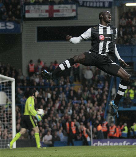 Newcastle&#39;s Papiss Cisse jumps high as he celebrates scoring a goal during the English Premier League soccer match between Chelsea and Newcastle United at Stamford Bridge Stadium in London, Wednesday, May 2, 2012. &#40;AP Photo&#47;Kirsty Wigglesworth&#41; <span class=meta>(AP Photo&#47; Kirsty Wigglesworth)</span>