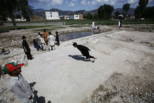 "<div class=""meta image-caption""><div class=""origin-logo origin-image ""><span></span></div><span class=""caption-text"">Pakistani boys play at the demolished compound of Osama bin Laden, in Abbottabad, Pakistan, Wednesday, May 2, 2012. On May 2, 2011, Osama bin Laden, the face of global terrorism and architect of the Sept. 11, 2001, attacks, was killed in a firefight with elite American forces at his Pakistan compound, then quickly buried at sea in a stunning finale to a furtive decade on the run. (AP Photo/Muhammed Muheisen) (AP Photo/ Muhammed Muheisen)</span></div>"