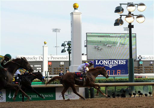 Jockey Mario Gutierrez rides I'll Have Another to victory in the 138th Kentucky Derby horse race at Churchill Downs Saturday, May 5, 2012, in Louisville, Ky. (AP Photo/Charlie Riedel)