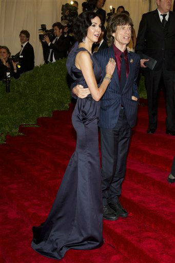 Mick Jagger and L&#39;Wren Scott  arrive at the Metropolitan Museum of Art Costume Institute gala benefit, celebrating Elsa Schiaparelli and Miuccia Prada, Monday, May 7, 2012 in New York. &#40;AP Photo&#47;Charles Sykes&#41; <span class=meta>(AP Photo&#47; Charles Sykes)</span>