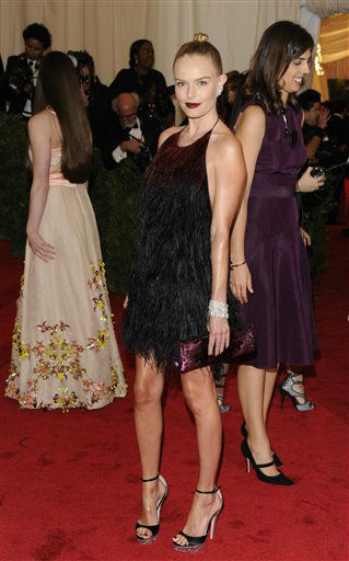 "<div class=""meta ""><span class=""caption-text "">Kate Bosworth arrives at the Metropolitan Museum of Art Costume Institute gala benefit, celebrating Elsa Schiaparelli and Miuccia Prada, Monday, May 7, 2012 in New York. (AP Photo/Evan Agostini) (AP Photo/ Evan Agostini)</span></div>"