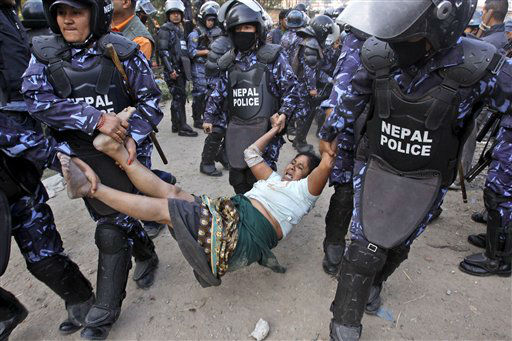 "<div class=""meta ""><span class=""caption-text "">Nepalese riot police detain a squatter residing on the banks of the Bagmati River in Katmandu, Nepal, Tuesday, May 8, 2012. Government forces have reportedly vacated more than 200 squatters who have set up their homes illegally along the banks of the river. (AP Photo/Binod Joshi) (AP Photo/ Binod Joshi)</span></div>"