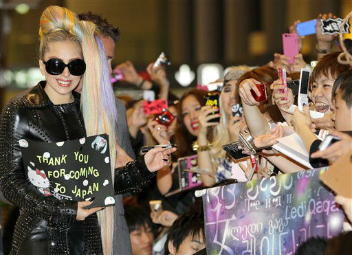 Lady Gaga, left, is welcomed by fans upon her arrival at Narita international airport in Narita, east of Tokyo, Tuesday, May 8, 2012. The American singer on a Asian tour schedules to hold three concerts this week in Saitama, north of Tokyo. &#40;AP Photo&#47;Shizuo Kambayashi&#41; <span class=meta>(AP Photo&#47; Shizuo Kambayashi)</span>