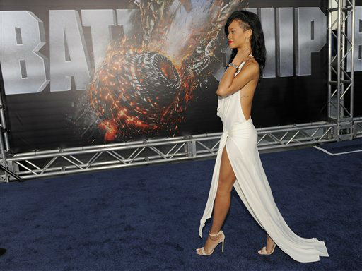 "<div class=""meta ""><span class=""caption-text "">Rihanna, a cast member in ""Battleship,"" walks the carpet at the American premiere of the film, Thursday, May 10, 2012, in Los Angeles. The film is released in theaters on May 18. (AP Photo/Chris Pizzello) (AP Photo/ Chris Pizzello)</span></div>"