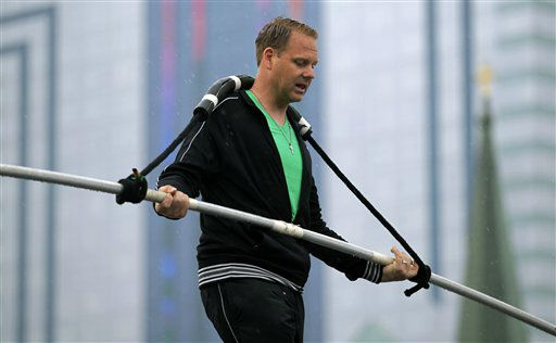 FILE - This May 16, 2012 photo shows Nik Wallenda performing a walk on a tightrope in the rain during training for his walk over Niagara Falls in Niagara Falls, N.Y. Wallenda can&#39;t visit a new place without envisioning a wire strung high above his head: Linking buildings, landmarks, nations. Even as a 6-year-old at Niagara Falls with his parents, he pictured walking a tightrope over the raging, whitewater maw. Now 33, he&#39;s ready to live out that childhood fantasy when he attempts Friday, June 15, 2012 to become the first person ever to walk a tightrope directly over the brink of Niagara Falls. &#40;AP Photo&#47;David Duprey&#41; <span class=meta>(AP Photo&#47; David Duprey)</span>