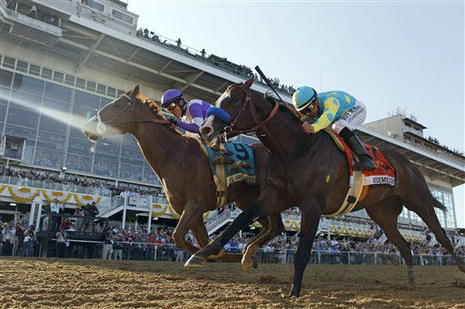 "<div class=""meta ""><span class=""caption-text "">I'll Have Another (9), ridden by Mario Gutierrez, beats Bodemeister, ridden by Mike Smith, to the finish line to win the 137th Preakness Stakes horse race at Pimlico Race Course, Saturday, May 19, 2012, in Baltimore.(AP Photo/Matt Slocum) (AP Photo/ Matt Slocum)</span></div>"