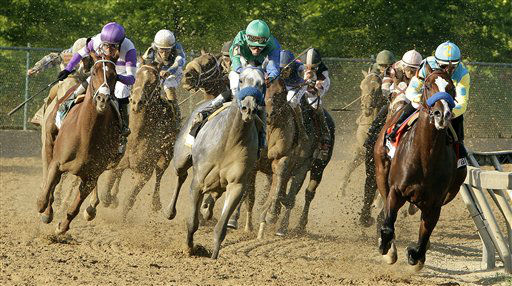 I&#39;ll Have Another, left, ridden by Mario Gutierrez, moves up as they enter the stretch to challenge Bodemeister, right on the rail, ridden by Mike Smith, and Creative Cause, center, ridden by Joel Rosario, during the 137th Preakness Stakes horse race at Pimlico Race Course, Saturday, May 19, 2012, in Baltimore. I&#39;ll Have Another won the race.&#40;AP Photo&#47;Garry Jones&#41; <span class=meta>(AP Photo&#47; Garry Jones)</span>