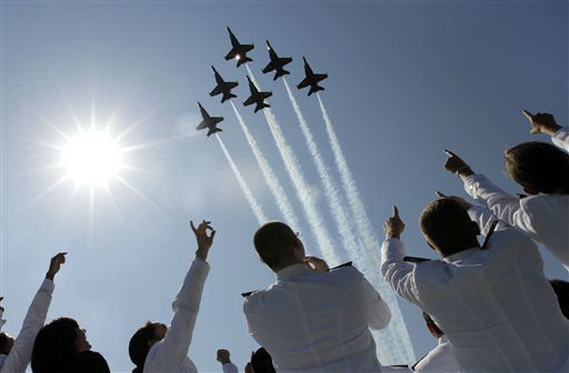 A formation of U.S. Navy Blue Angel fighter jets perform a flyover above graduating Midshipmen during the United States Naval Academy graduation and commissioning ceremonies in Annapolis, Md., Tuesday, May 29, 2012. (AP Photo/Patrick Semansky)