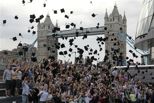 Backdropped by Tower Bridge, hundreds of students from more than 100 nationalities toss their mortar boards into the air in a Guinness World Record attempt for the most people throwing mortar boards simultaneously outside City Hall in London as part of World Record London to mark the news that more international students than ever are now studying in London, Wednesday, May 30, 2012. 295 students took part and set a new Guinness World Record. &#40;AP Photo&#47;Sang Tan&#41; <span class=meta>(AP Photo&#47; Sang Tan)</span>