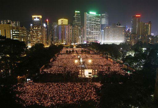 "<div class=""meta ""><span class=""caption-text "">Tens of thousands of people attend a candlelight vigil at Hong Kong's Victoria Park Monday, June 4, 2012 to mark the 23rd anniversary of the Chinese military crackdown on the pro-democracy movement in Beijing. (AP Photo/Kin Cheung) (AP Photo/ Kin Cheung)</span></div>"
