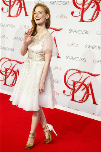 "<div class=""meta image-caption""><div class=""origin-logo origin-image ""><span></span></div><span class=""caption-text"">Jessica Chastain arrives at the CFDA Fashion Awards on Monday, June 4, 2012, in New York. (Photo by Charles Sykes/Invision/AP) (Photo/Charles Sykes)</span></div>"