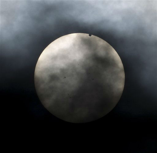 "<div class=""meta image-caption""><div class=""origin-logo origin-image ""><span></span></div><span class=""caption-text"">Venus begins to pass in front of the sun, as visible from New York, Tuesday, June 5, 2012. From the U.S. to South Korea, people around the world turned their attention to the daytime sky on Tuesday and early Wednesday in Asia to make sure they caught the once-in-a-lifetime sight of the transit of Venus, which won't be seen for another 150 years. (AP Photo/Seth Wenig) (AP Photo/ Seth Wenig)</span></div>"