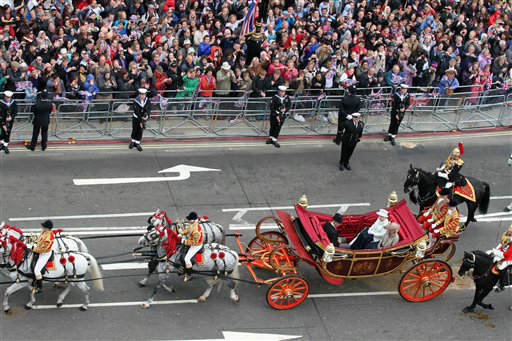 Britain&#39;s Queen E;izabeth in carriage 2nd right,  sits with  Rrince Charles and Camilla  Duchess of Cornwall,  as they head for Buckingham Palace in a carriage procession in London Tuesday June 5, 2012. The carriage procession is part of a four-day Diamond Jubilee celebration to markthe 60th anniversary of Queen Elizabeth II accession to the throne &#40;AP Photo&#47;Elizabeth Dalziel&#47;Pool&#41; <span class=meta>(AP Photo&#47; Elizabeth Dalziel)</span>