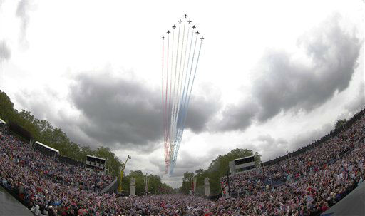 Royal Air force Red Arrow display team fly pass Buckingham Palace in London where Britain Queen Elizabeth II watches from the palace balcony as part of a four-day Diamond Jubilee celebration to mark the 60th anniversary of  Queen Elizabeth II accession to the throne, Tuesday, June 5, 2012. &#40;AP Photo&#47;Sang Tan&#41; <span class=meta>(AP Photo&#47; Sang Tan)</span>