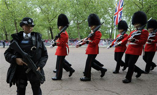 Soldiers move along The Mall to take their positions as part of Queen Elizabeth II  Diamond Jubilee celebrations, London, Tuesday June 5, 2012. Queen Elizabeth II will make a rare address to the nation at the conclusion of festivities marking her 60 years on the throne. &#40;AP Photo&#47;Tom Hevezi&#41; <span class=meta>(AP Photo&#47; Tom Hevezi)</span>