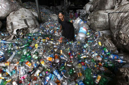 "<div class=""meta image-caption""><div class=""origin-logo origin-image ""><span></span></div><span class=""caption-text"">A woman worker sorts used plastic bottles at a recycle center in Mumbai, India, Tuesday, June 5, 2012. World Environment Day is celebrated June 5 every year by the United Nations to stimulate global awareness on environmental issues. (AP Photo/ Rajanish Kakade) (AP Photo/ Rajanish Kakade)</span></div>"