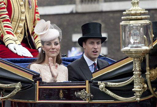 Princess Kate and Prince William ride during the procession to Buckingham Palace on the last day of Queen Elizabeth II jubilee, Tuesday, June 5, 2012, in London. &#40;AP Photo&#47;Harry Hamburg&#41; <span class=meta>(AP Photo&#47; Harry Hamburg)</span>