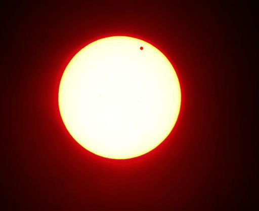 "<div class=""meta image-caption""><div class=""origin-logo origin-image ""><span></span></div><span class=""caption-text"">In this photo made using a red filter, Venus begins to pass in front of the sun, as visible from from Overland Park, Kan.on Tuesday, June 5, 2012. From the U.S. to South Korea, people around the world turned their attention to the daytime sky on Tuesday and early Wednesday in Asia to make sure they caught the once-in-a-lifetime sight of the transit of Venus, which won't be seen for another 150 years. (AP Photo/Charlie Riedel) (AP Photo/ Charlie Riedel)</span></div>"