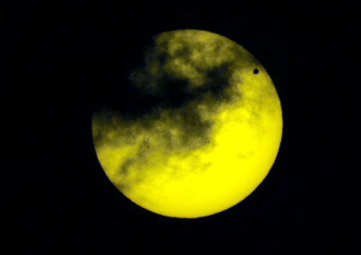 "<div class=""meta image-caption""><div class=""origin-logo origin-image ""><span></span></div><span class=""caption-text"">Venus, upper right, transits the sun as seen through a dark glass from Quito, Ecuador, Tuesday, June 5, 2012. From the U.S. to South Korea, people around the world turned their attention to the daytime sky on Tuesday and early Wednesday in Asia to make sure they caught the once-in-a-lifetime sight of the transit of Venus, which won't be seen for another 150 years. (AP Photo/Dolores Ochoa) (AP Photo/ Dolores Ochoa)</span></div>"