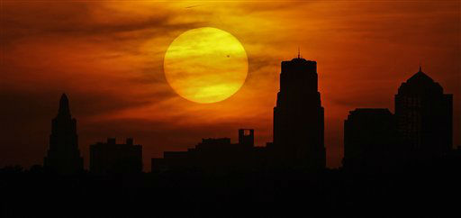 Venus is silhouetted as it crosses in front of the sun as it sets behind the Kansas City, Mo. skyline Tuesday, June 5, 2012. From the U.S. to South Korea, people around the world turned their attention to the daytime sky on Tuesday and early Wednesday in Asia to make sure they caught the once-in-a-lifetime sight of the transit of Venus, which won&#39;t be seen for another 105 years. &#40;AP Photo&#47;Charlie Riedel&#41; <span class=meta>(AP Photo&#47; Charlie Riedel)</span>