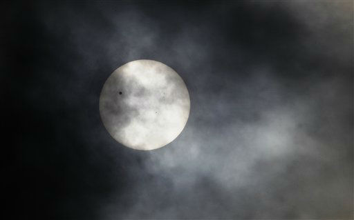 Planet Venus, pictured as a black dot, left, is seen in transit across the sun, in Bangalore, India, Wednesday, June 6, 2012. People around the world turned their attention to the daytime sky on Tuesday and early Wednesday in Asia to make sure they caught the rare sight of the transit of Venus. &#40;AP Photo&#47;Aijaz Rahi&#41; <span class=meta>(AP Photo&#47; Aijaz Rahi)</span>