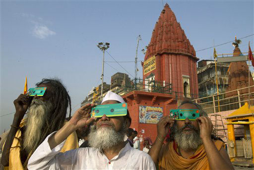 "<div class=""meta image-caption""><div class=""origin-logo origin-image ""><span></span></div><span class=""caption-text"">Hindu holy men use special cardboard eclipse glasses as they watch the transit of Venus on the banks of the Ganges River in Varanasi, India, Wednesday, June 6, 2012. People around the world turned their attention to the daytime sky on Tuesday and early Wednesday in Asia to make sure they caught the rare sight of the transit of Venus. (AP Photo/Rajesh Kumar Singh) (AP Photo/ Rajesh Kumar Singh)</span></div>"