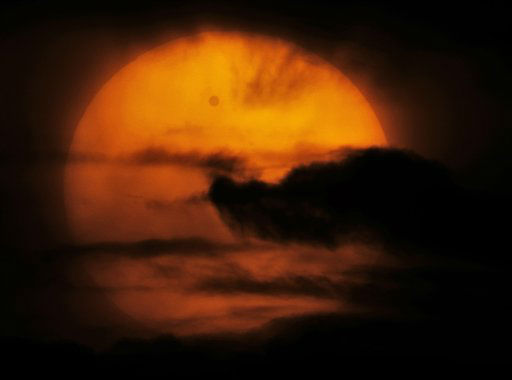 "<div class=""meta ""><span class=""caption-text "">Venus is seen passing in front of the sun in the clouds, in this image taken through a telescope, from Losevo village, north of St. Petersburg, Russia, Wednesday, June 6, 2012. People around the world turned their attention to the daytime sky on Tuesday and early Wednesday in Asia to make sure they caught the rare sight of the transit of Venus. (AP Photo/Dmitry Lovetsky) (AP Photo/ Dmitry Lovetsky)</span></div>"